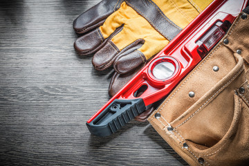 Composition of construction level protective gloves leather tool