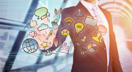 Businessman touching multimedia icons on a technology interface - Creativity concept