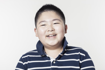 A fat boy portrait with smile isolated white.