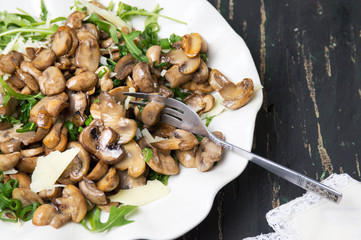 Fried mushrooms with vegetables on a plate