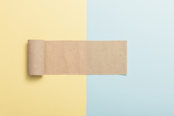 brown rolling paper on the color(yellow, blue) paper background.