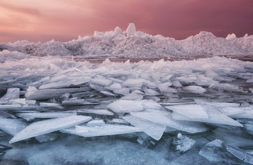 Frozen sea during sunset. Beautiful natural seascape in the winter time