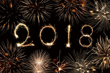 2018 written with sparkles and fireworks