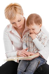 Mother and baby embracing , reading book