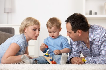 Caucasian family playing together at home