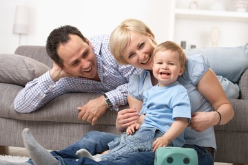 Parents laughing with baby