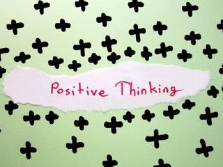 """green on the ground """"positive thinking"""" and plus signs.thought."""