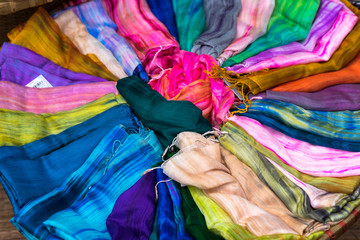 Fotobehang Paradijsvogel Stack of colourful silk scarfs