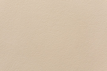 Beige painted stucco wall.