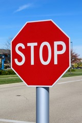 The red octagon stop sign on a close up view.