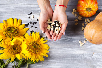 Woman Holding A Handful Of Healthy Seeds