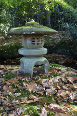 Traditional stone Japanese lantern in autumn