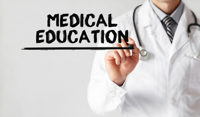 Doctor writing word medical education with marker, Medical concept