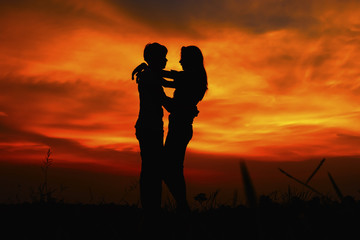 Silhouette of a couple at the sunset.