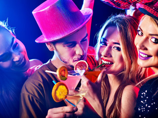 Cocktail party for couple in love disco dancing and drink . Happy women in evening dresses and men have fun in night club . Rest after hard day at work on loving date.