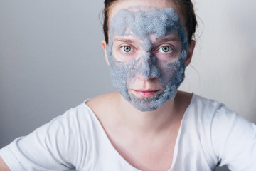 Beautiful young woman with hydrating bubble mask