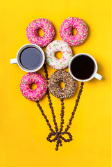 Fototapete - Balloon with donuts and cups of coffee on yellow background