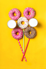 Fototapete - Balloon of donuts and milk on yellow background