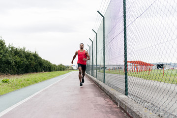 Man running along fence