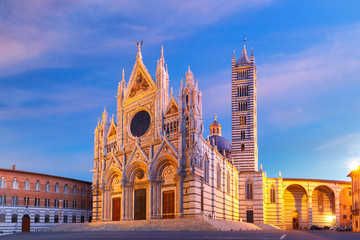 Beautiful view of facade and campanile of Siena Cathedral, Duomo di Siena at sunrise, Siena, Tuscany, Italy