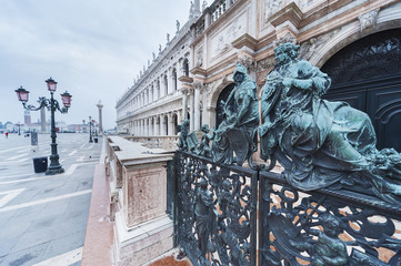Fototapete - Decorative metal gate ornament. Antique iron door with classic ornaments of Campanile in Doge's palace, Venice, Italy