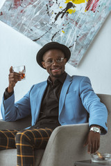 african american man with glass of whiskey