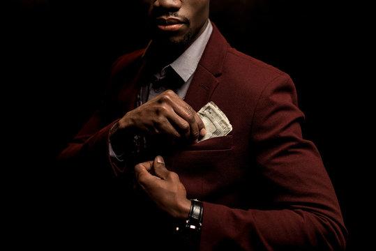 man with dollar banknotes