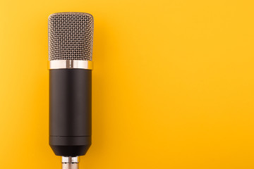 Microphone on a yellow background
