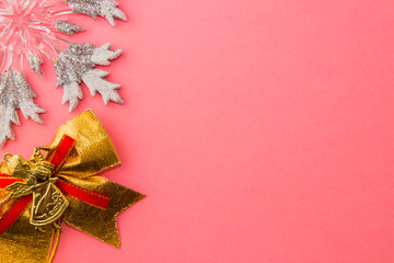 Christmas toys on a pink background
