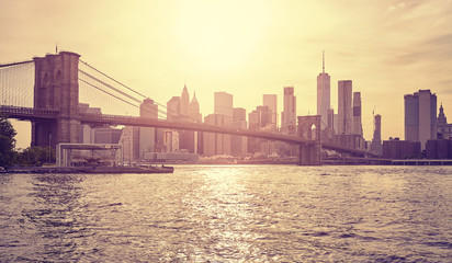 Vintage stylized picture of New York City at sunset, USA.