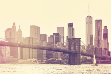 Retro stylized picture of New York City at sunset, USA.
