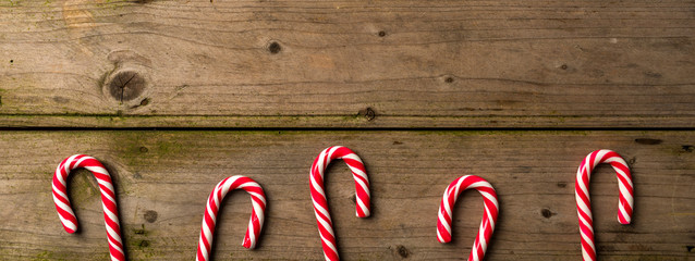 Candy cane on an old wooden table