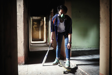 A young person with a baseball bat