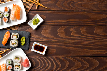 Set of Japanese sushi on wooden table. Top view