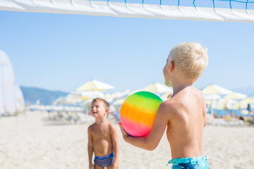 Young boys playing Beach Volleyball