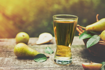 Glass of pear juice and ripe pears