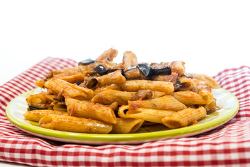 Pasta with aubergine and tomato sauce on a the table