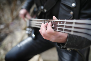 Rock guitarist on the steps. A musician with a bass guitar in a