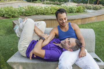 Gay couple sitting on a bench together