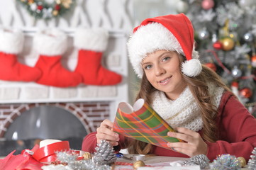 teenage girl preparing to Christmas