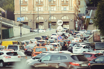 big traffic jam on the road in the city, cars are standing