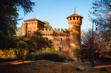 Turin (Piedmont, Italy), the famous Borgo Medievale, neo-gothic castle in the Valentino public park during autumn