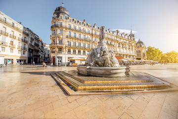 Canvas Prints Historical buildings View on the Comedy square with fountain of Three Graces during the morning light in Montpellier city in southern France