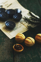 Homebaked dessert with caramel filling and nuts on wooden rusted background