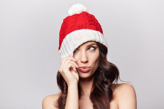 smiling beautiful girl in christmas cap