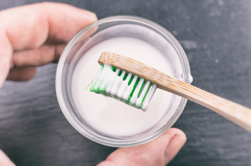 Baking soda paste on a toothbrush