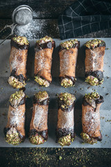 Traditional Sicilian homemade cannoli with pistachios