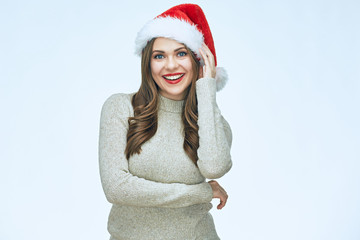 Smiling young woman wearing Santa christmas hat.