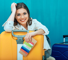 Happy woman ready for travel with suitcase.