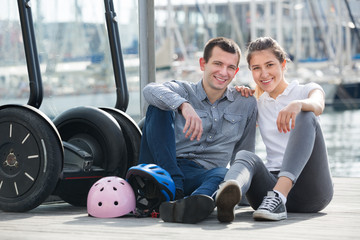 Man and woman with segways
